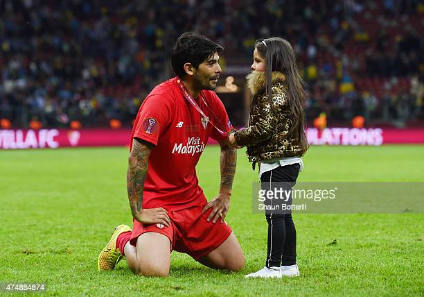 Ever Banega of Sevilla celebrates victory with his daughter after the UEFA Europa League Final match between FC Dnipro Dnipropetrovsk and FC Sevilla...