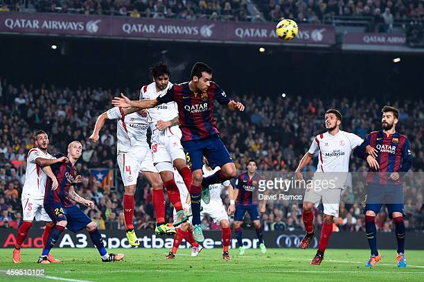 Ever Banega of Sevilla FC clear the ball under pressure from Sergio Busquets of FC Barcelona during the La Liga mach between FC Barcelona and Sevilla...