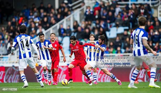 Ever Banega of Sevilla FC duels for the ball withÊEsteban Granero of Real Sociedad during the La Liga match between Real Sociedad and Sevilla FC at...