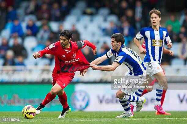 Ever Banega of Sevilla FC duels for the ball withÊJoseba Zaldua of Real Sociedad during the La Liga match between Real Sociedad and Sevilla FC at...