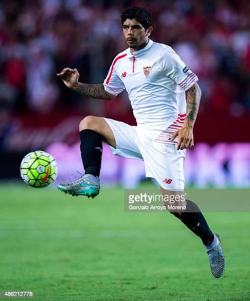 Ever Banega of Sevilla FC strikes the ball during the La Liga match between Sevilla FC and Club Atletico de Madrid at Estadio Ramon Sanchez Pizjuan...