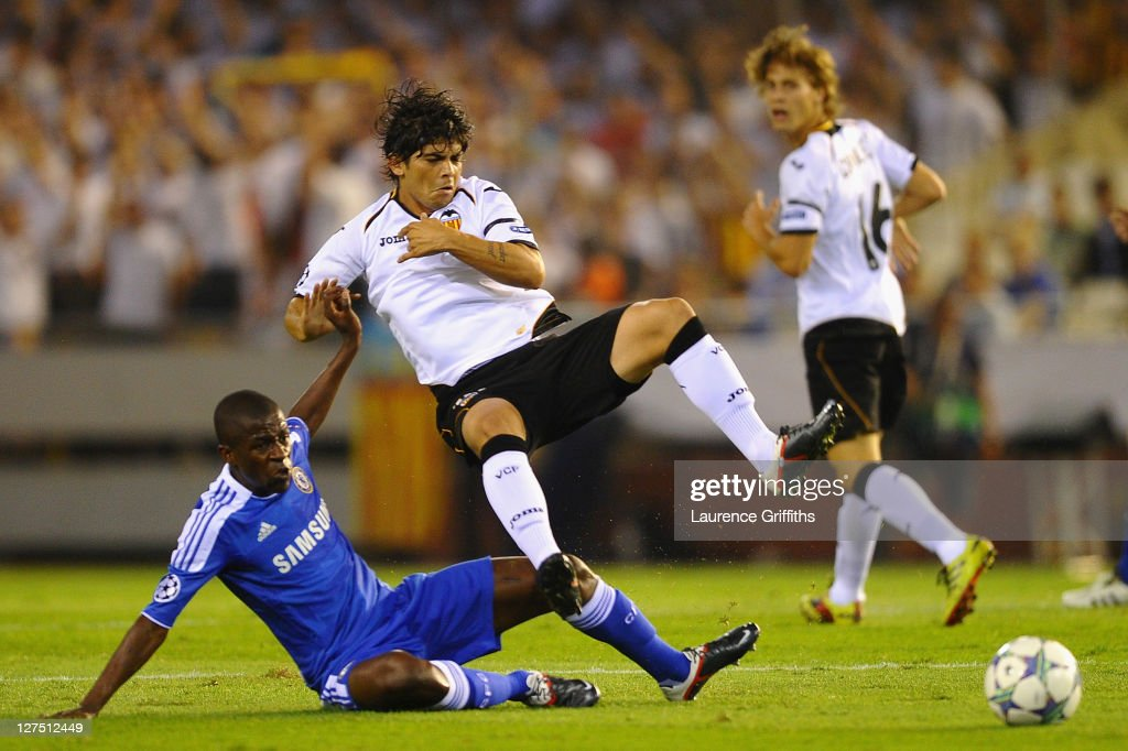 <a gi-track='captionPersonalityLinkClicked' href=/galleries/search?phrase=Ever+Banega&family=editorial&specificpeople=4100796 ng-click='$event.stopPropagation()'>Ever Banega</a> of Valencia is tackled by Ramires of Chelsea during the UEFA Champions League Group E match between Valencia CF and Chelsea at the Estadio Mestalla on September 28, 2011 in Valencia, Spain.