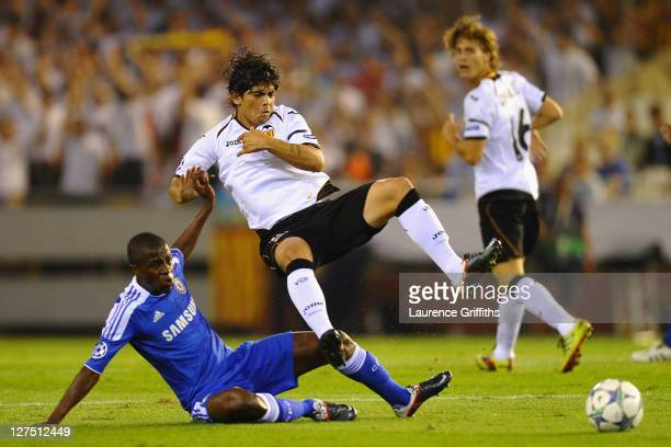 Ever Banega of Valencia is tackled by Ramires of Chelsea during the UEFA Champions League Group E match between Valencia CF and Chelsea at the...
