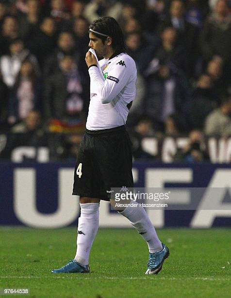 Ever Banega of Valencia leaves the field after receiving the Red card during the UEFA Europa League round of 16 first leg match between Valencia and...