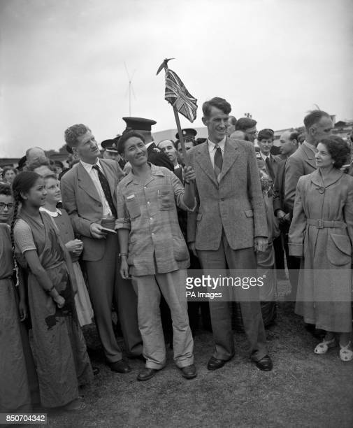 Everest conquerors Edmund Hillary of New Zealand and Sherpa Tensing Norkey who is waving a Union Flag stepped from a BOAC airliner to one of the...