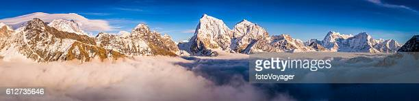 Everest NP mountain peaks above the clouds panorama Himalayas Nepal