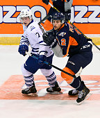 Everett Clark of the Mississauga Steelheads skates with Alex Peters of the Flint Firebirds during OHL game action on October 4 2015 at the Hershey...