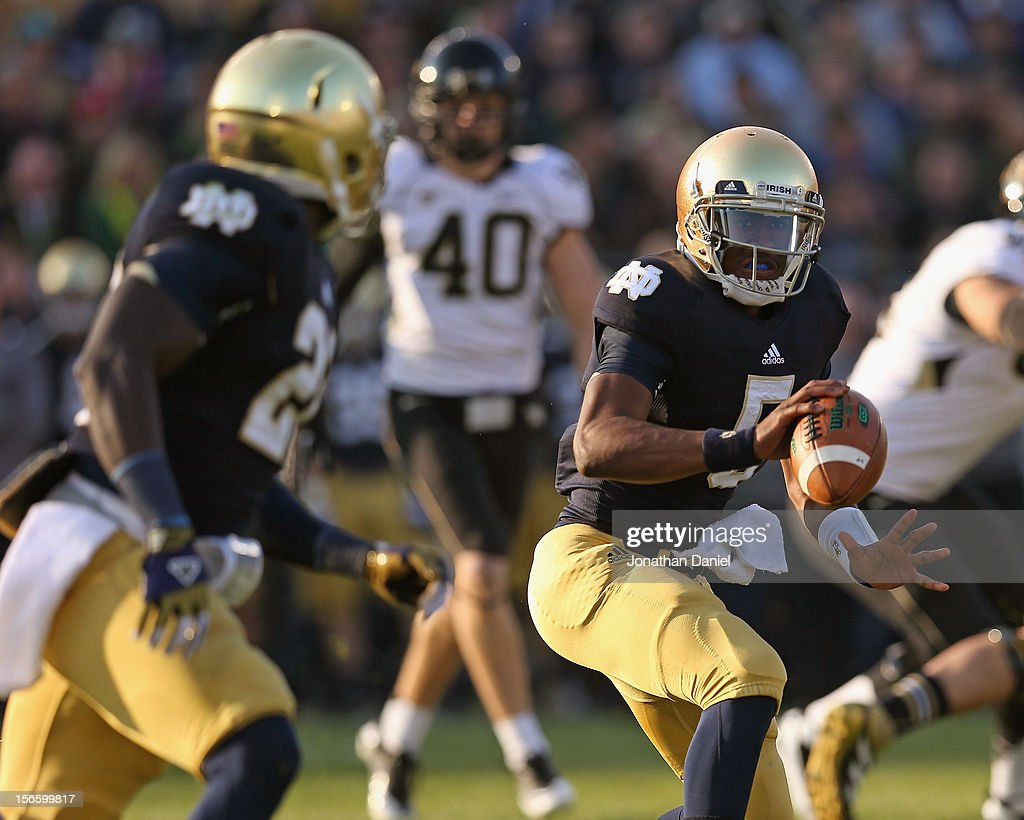 Everett Colson #5 of the Notre Dame Fighting Irish pitches the ball to Cierre Wood #20 on a 60 yard touchdown play against the Wake Forest Demon Deacons at Notre Dame Stadium on November 17, 2012 in South Bend, Indiana.