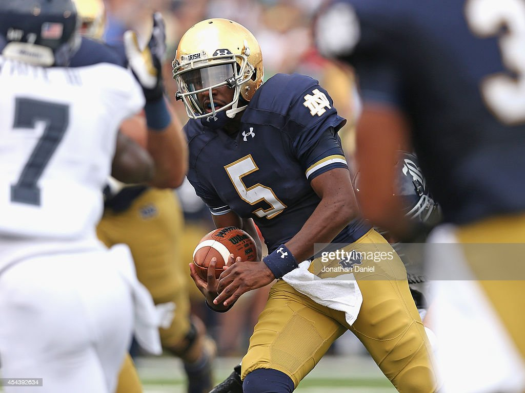 <a gi-track='captionPersonalityLinkClicked' href=/galleries/search?phrase=Everett+Golson&family=editorial&specificpeople=9688386 ng-click='$event.stopPropagation()'>Everett Golson</a> #5 of the Norte Dame Fighting Irish runs for a touchdown against the Rice Owls at Notre Dame Stadium on August 30, 2014 in South Bend, Indiana.