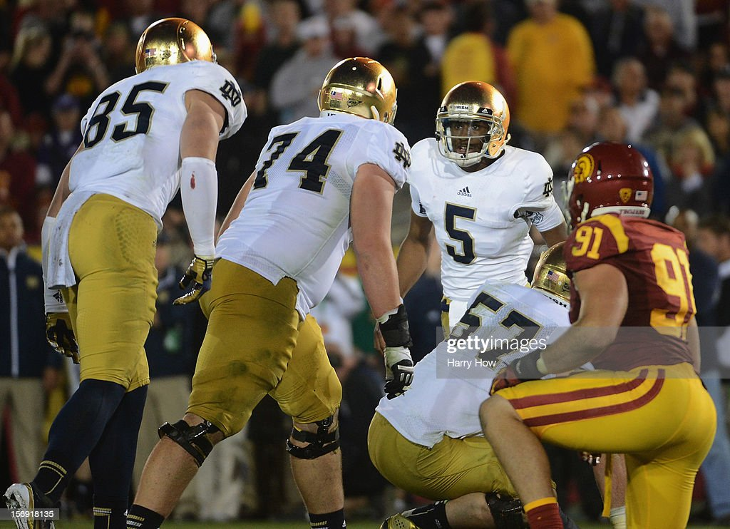Everett Golson #5 of the Notre Dame Fighting Irish calls a play at the line during a 22-13 Notre Dame win over the USC Trojans at Los Angeles Memorial Coliseum on November 24, 2012 in Los Angeles, California.