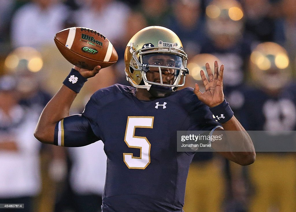 <a gi-track='captionPersonalityLinkClicked' href=/galleries/search?phrase=Everett+Golson&family=editorial&specificpeople=9688386 ng-click='$event.stopPropagation()'>Everett Golson</a> #5 of the Notre Dame Fighting Irish passes against the Michigan Wolverines at Notre Dame Stadium on September 6, 2014 in South Bend, Indiana.