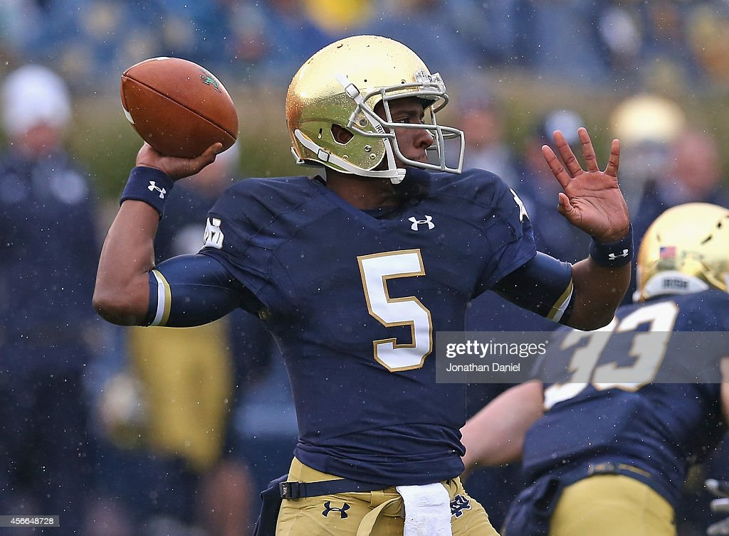 <a gi-track='captionPersonalityLinkClicked' href=/galleries/search?phrase=Everett+Golson&family=editorial&specificpeople=9688386 ng-click='$event.stopPropagation()'>Everett Golson</a> #5 of the Notre Dame Fighting Irish passes against the Standford Cardinal at Notre Dame Stadium on October 4, 2014 in South Bend, Indiana.