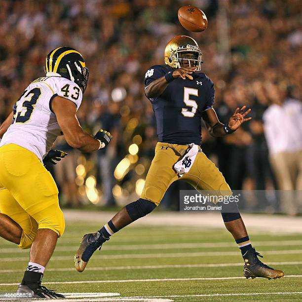 Everett Golson of the Notre Dame Fighting Irish passes as Chris Wormley of the Michigan Wolverines chases at Notre Dame Stadium on September 6 2014...