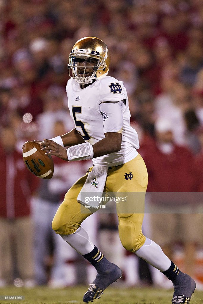 Everett Golson #5 of the Notre Dame Fighting Irish scrambles looking for a receiver during a game against the Oklahoma Sooners at Gaylord Family Oklahoma Memorial Stadium on October 27, 2012 in Norman, Oklahoma. The Fighting Irish defeated the Sooners 30-13.