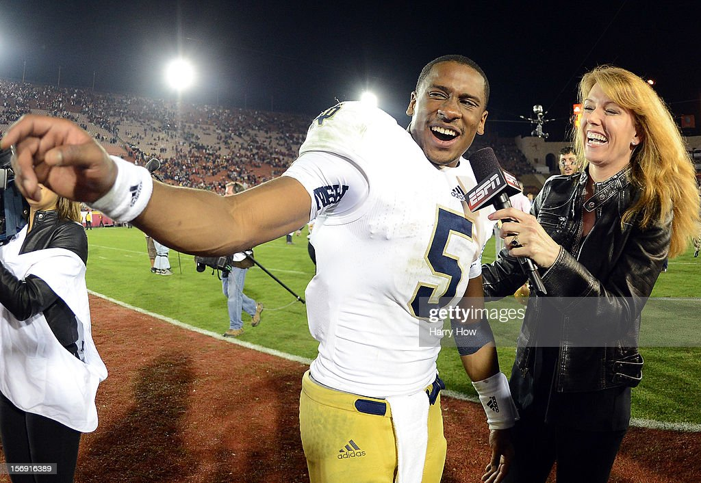 Everett Golson #5 of the Notre Dame Fighting Irish smiles as he gives an interview to Heather Cox of ESPN after a 22-13 win over the USC Trojans at Los Angeles Memorial Coliseum on November 24, 2012 in Los Angeles, California.