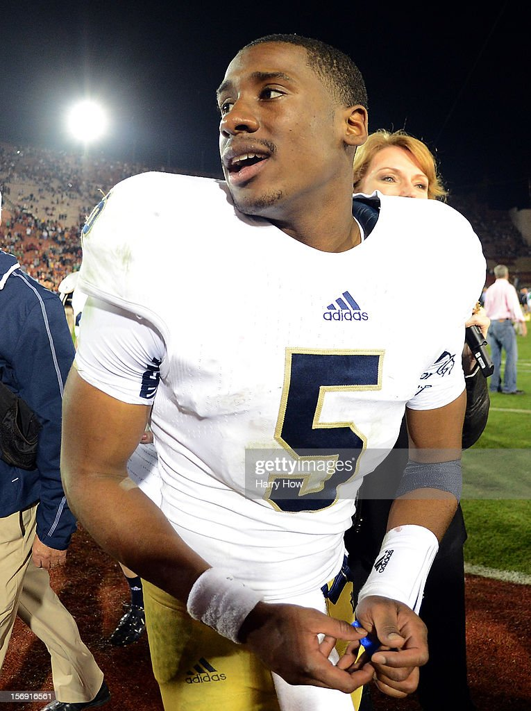 Everett Golson #5 of the Notre Dame Fighting Irish smiles as he leaves the field after a 22-13 win over the USC Trojans at Los Angeles Memorial Coliseum on November 24, 2012 in Los Angeles, California.