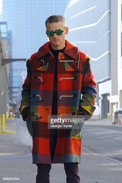 Everett Williams seen at Skylight Clarkson Sq outside the Duckie Brown show wearing multi colored vintage pea coat Acne Studios pants and Rag Bone...