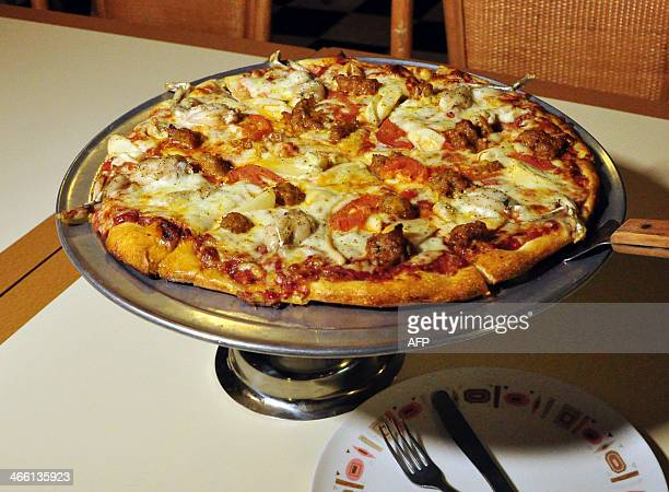 MEYER 'Everglades Pizza' is seen on January 28 2014 at Neighborhood Pizza in the Gulf Coast city of Fort Myers Florida The pie has python meat...