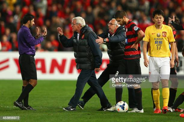 Evergrande coach Marcello Lippi marches onto the pitch during the Asian Champions League Final match between the Western Sydney Wanderers and...