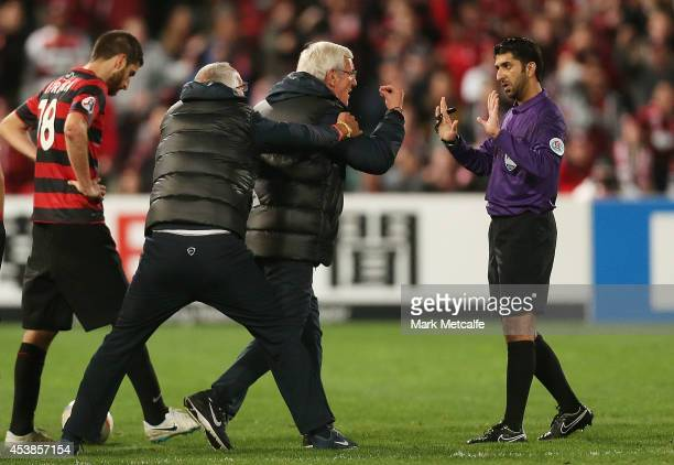 Evergrande coach Marcello Lippi remonstrates with the referee on the pitch following a red card given to Gao Lin of Evergrande during the Asian...
