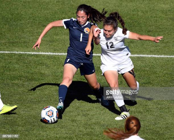 Evergreen Rachel Stup and D'Evelyn Isabella Scaturro battle for he ball in the first half during the 2017 CHSAA Girls Soccer State Championship Class...