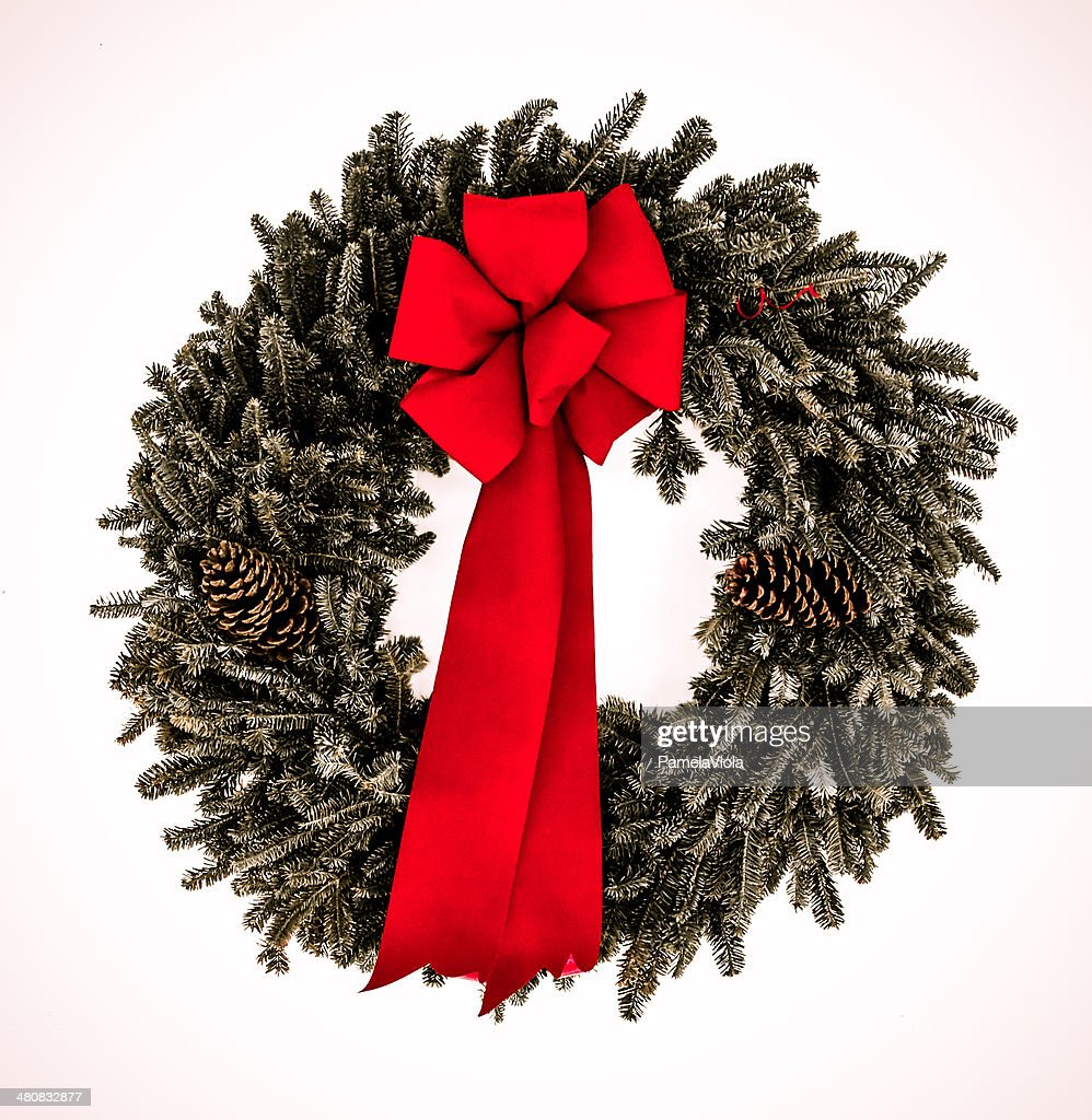 Evergreen wreath with red bow : Stock Photo