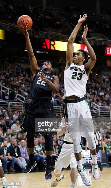 Everson Davis of the Binghamton Bearcats goes to the basket against Deyonta Davis of the Michigan State Spartans during the second half at Breslin...