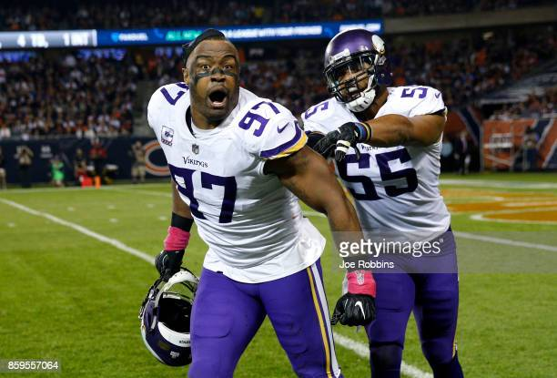 Everson Griffen and Anthony Barr of the Minnesota Vikings celebrate after Griffen stripped the football from quarterback Mitchell Trubisky of the...