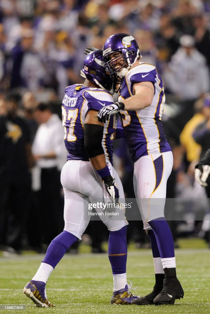 Everson Griffen #97 and <a gi-track='captionPersonalityLinkClicked' href=/galleries/search?phrase=Jared+Allen&family=editorial&specificpeople=239098 ng-click='$event.stopPropagation()'>Jared Allen</a> #69 of the Minnesota Vikings celebrate a sack of Aaron Rodgers #12 of the Green Bay Packers during the fourth quarter of the game on December 30, 2012 at Mall of America Field at the Hubert H. Humphrey Metrodome in Minneapolis, Minnesota. The Vikings defeated the Packers 37-34.