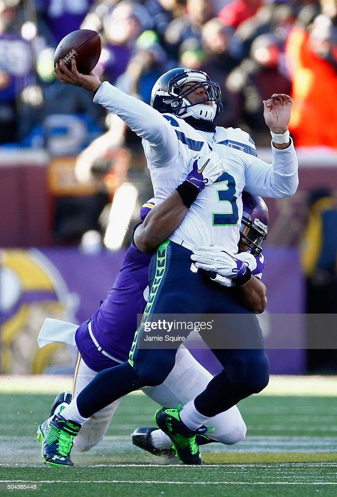 Everson Griffen #97 of the Minnesota Vikings attempts to tackle Russell Wilson #3 of the Seattle Seahawks in the fourth quarter during the NFC Wild Card Playoff game at TCFBank Stadium on January 10, 2016 in Minneapolis, Minnesota.