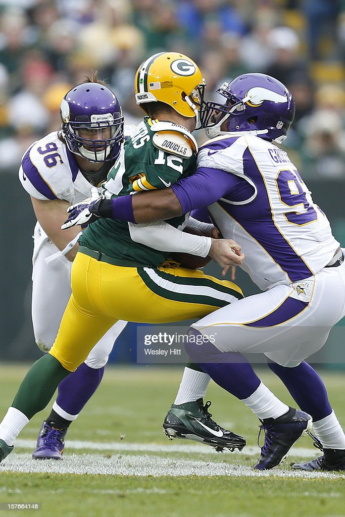 Everson Griffen #97 of the Minnesota Vikings sacks Aaron Rodgers #12 of the Green Bay Packers at Lambeau Field on December 2, 2012 in Green Bay, Wisconsin. The Packers defeated the Vikings 23-14.