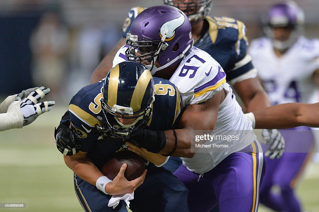 Everson Griffen #97 of the Minnesota Vikings sacks Austin Davis #9 of the St. Louis Rams in the fourth quarter at the Edward Jones Dome on September 7, 2014 in St. Louis, Missouri. The Vikings defeated the Rams 34-6.