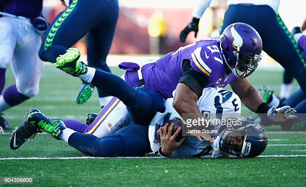 Everson Griffen of the Minnesota Vikings sacks Russell Wilson of the Seattle Seahawks in the third quarter during the NFC Wild Card Playoff game at...
