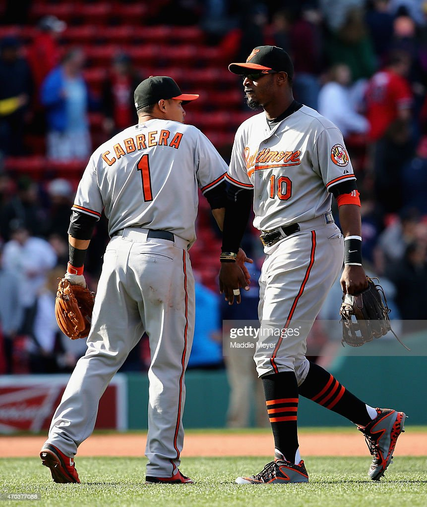 Everth Cabrera #1 of the Baltimore Orioles celebrates with Adam Jones #10 after their game against the Boston Red Sox at Fenway Park on April 19, 2015 in Boston, Massachusetts. The Orioles defeat the Red Sox 8-3.