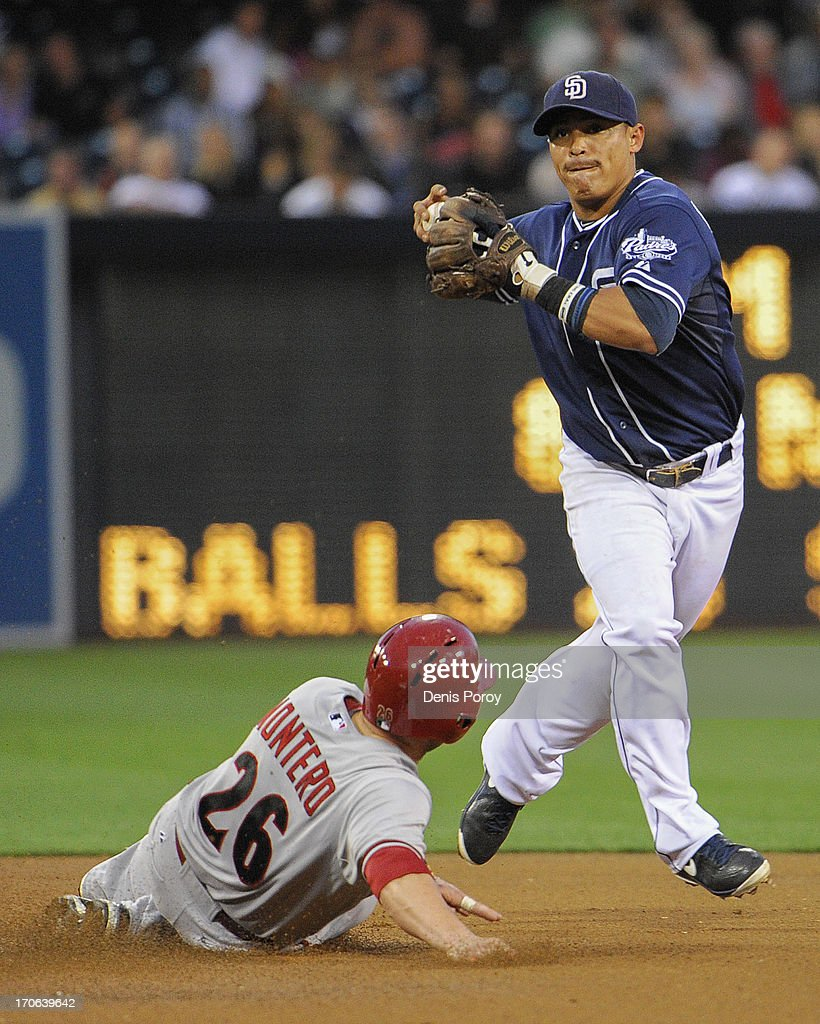 Everth Cabrera of the San Diego Padres can't turn a double play after getting the force out on Miguel Montero of the Arizona Diamondbacks during the...