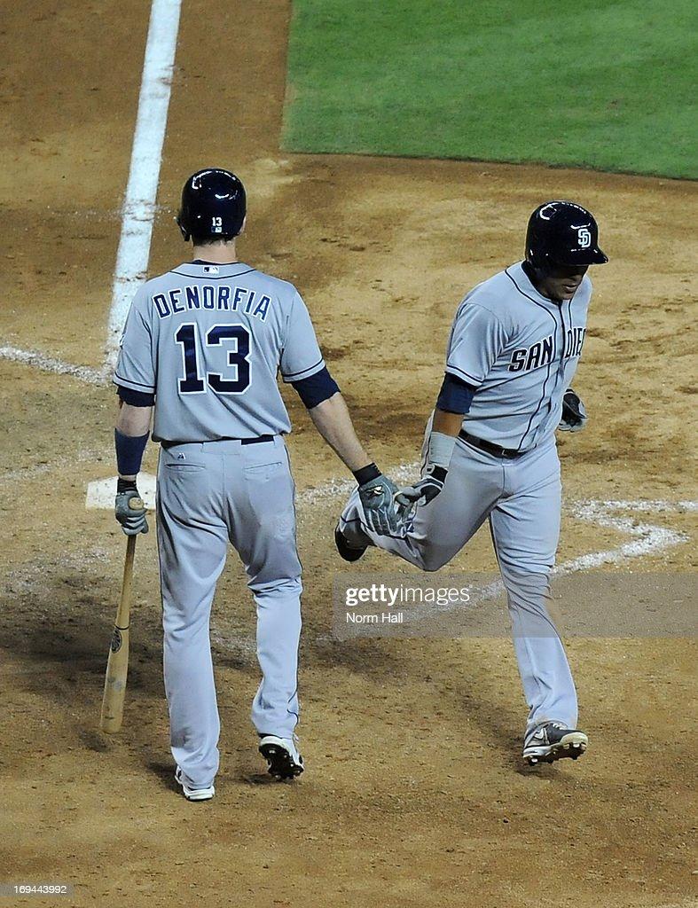 Everth Cabrera #2 of the San Diego Padres celebrates a home run with teammate Chris Denorfia #13 against the Arizona Diamondbacks at Chase Field on May 24, 2013 in Phoenix, Arizona.