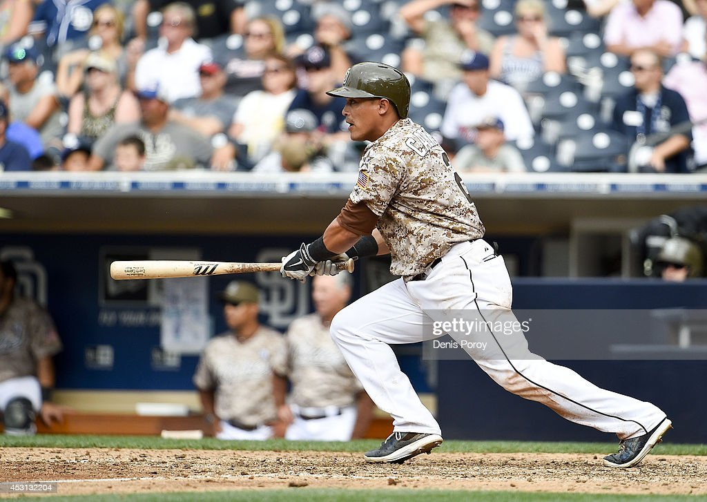 Everth Cabrera #2 of the San Diego Padres hits a walk-off single during the tenth inning of a baseball game against the Atlanta Braves at Petco Park August 3, 2014 in San Diego, California.