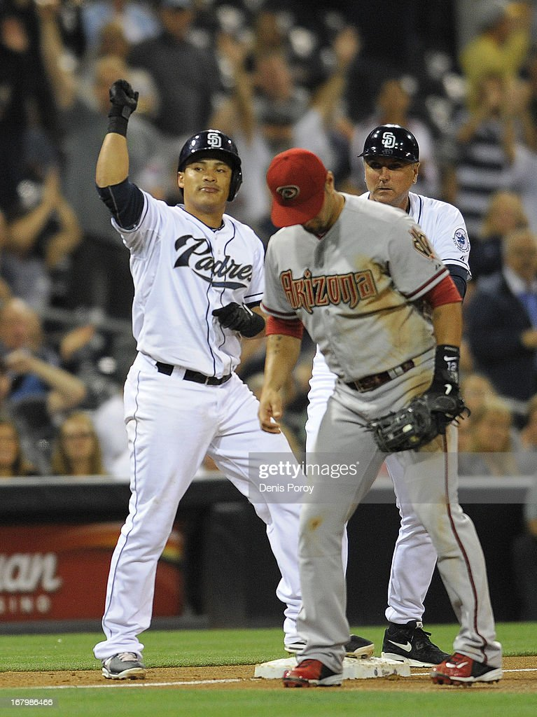 <a gi-track='captionPersonalityLinkClicked' href=/galleries/search?phrase=Everth+Cabrera&family=editorial&specificpeople=5743470 ng-click='$event.stopPropagation()'>Everth Cabrera</a> #2 of the San Diego Padres pumps his fist next to <a gi-track='captionPersonalityLinkClicked' href=/galleries/search?phrase=Eric+Chavez&family=editorial&specificpeople=201561 ng-click='$event.stopPropagation()'>Eric Chavez</a> #12 of the Arizona Diamondbacks after hitting an RBI triple in the second inning of a baseball game at Petco Park on May 3, 2013 in San Diego, California.