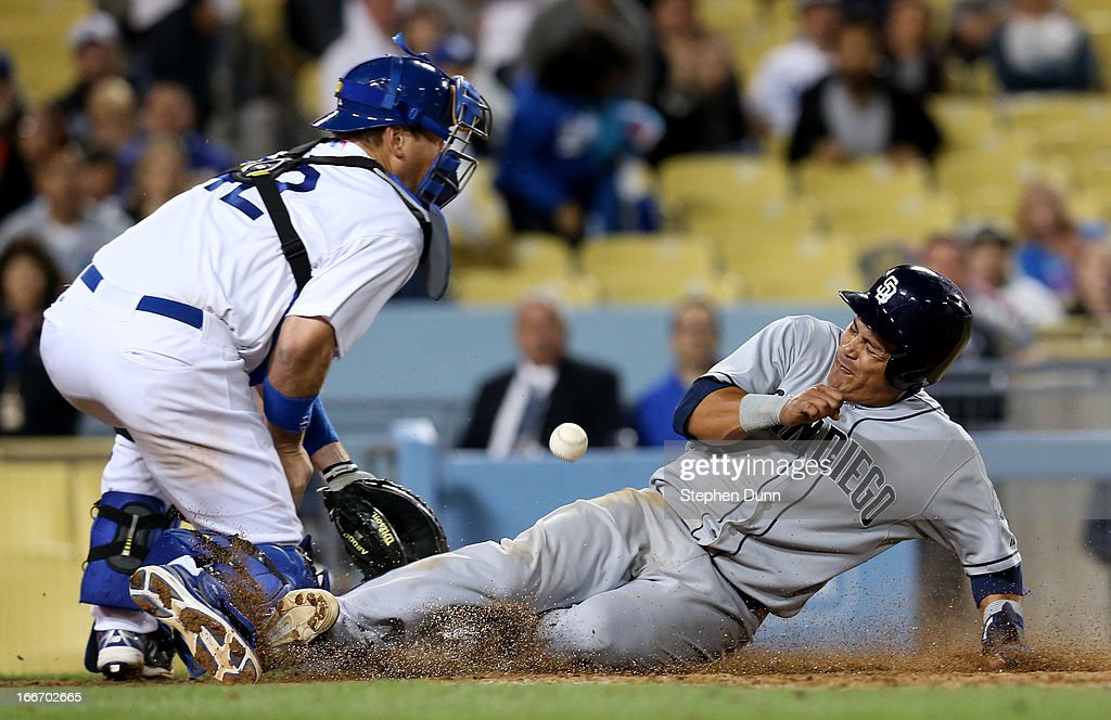 <a gi-track='captionPersonalityLinkClicked' href=/galleries/search?phrase=Everth+Cabrera&family=editorial&specificpeople=5743470 ng-click='$event.stopPropagation()'>Everth Cabrera</a> of the San Diego Padres scores on a sacrifice fly ahead of the throw to catcher A.J. Ellis of the Los Angeles Dodgers in the ninth inning at Dodger Stadium on April 15, 2013 in Los Angeles, California. All uniformed team members are wearing jersey number 42 in honor of Jackie Robinson Day.