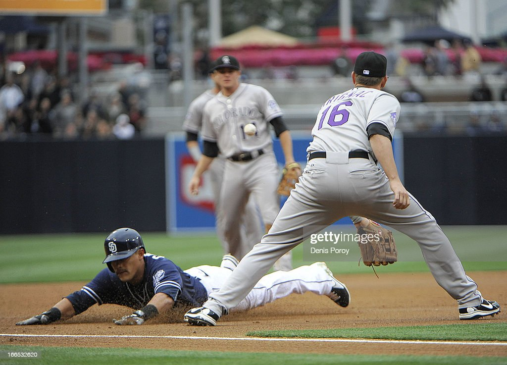 <a gi-track='captionPersonalityLinkClicked' href=/galleries/search?phrase=Everth+Cabrera&family=editorial&specificpeople=5743470 ng-click='$event.stopPropagation()'>Everth Cabrera</a> #2 of the San Diego Padres slides into third base with a triple ahead of the tag of <a gi-track='captionPersonalityLinkClicked' href=/galleries/search?phrase=Reid+Brignac&family=editorial&specificpeople=4175431 ng-click='$event.stopPropagation()'>Reid Brignac</a> #16 of the Colorado Rockies during the first inning of a baseball game at Petco Park on April 13, 2013 in San Diego, California.
