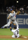 Everth Cabrera of the San Diego Padres tries to break up a double play as Mark Ellis of the Los Angeles Dodgers throws during the seventh inning of a...