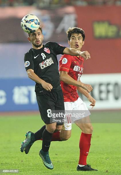 Everton Augusto De Barros Ribeiro of Al Ahli in action against Zheng Zhi of Guangzhou Evergrande during the Asian Champions League Final 2nd leg...