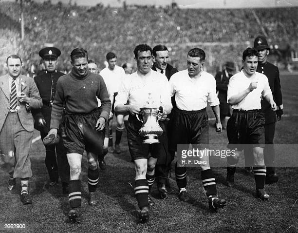 Everton captain Dixie Dean carry's the FA Cup trophy on a lap of honour around Wembley Stadium after his side's 30 victory over Manchester City in...