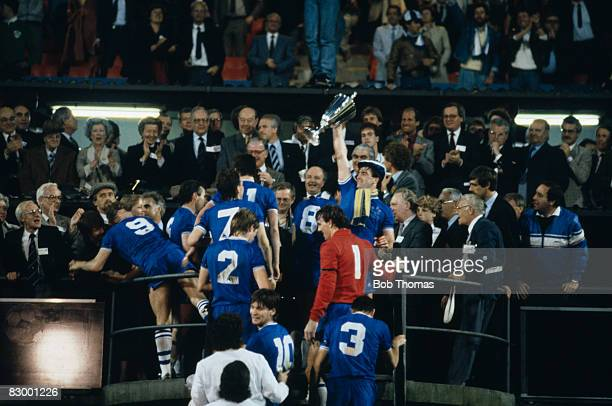 Everton captain Kevin Ratcliffe holds the trophy aloft after the presentation ceremony following their UEFA European Cup Winners Cup Final victory...