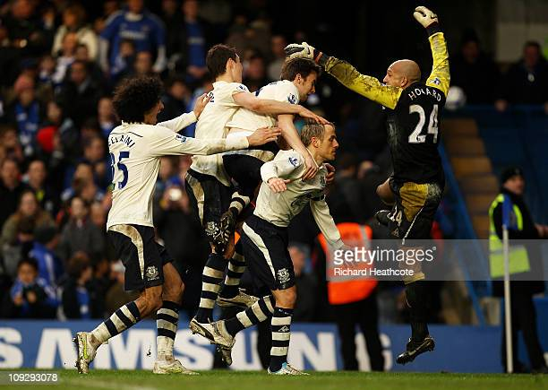 Everton captain Phil Neville celebrates with teammates after scoring the winning penalty to put his team through 43 on penalties during the FA Cup...