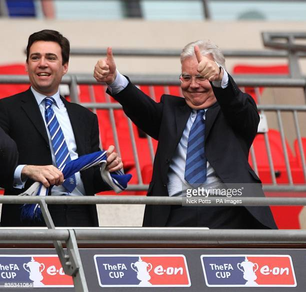 Everton chairman Bill Kenwright celebrates victory in the stands with Culture Secretary Andy Burnham
