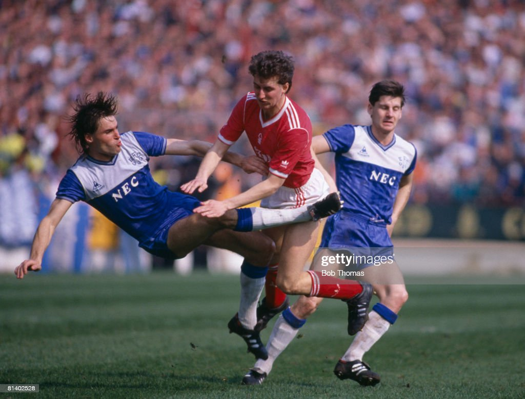 Everton defender Pat Van Den Hauwe clashes with Nottingham Forest's David Campbell as Everton's Paul Bracewell moves in during their 1st Divison...