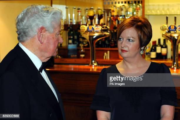 Everton Everton life president Sir Philip Carter talks with Melanie Jones the mother of murdered schoolboy Rhys Jones at the Liverpool Unites Charity...