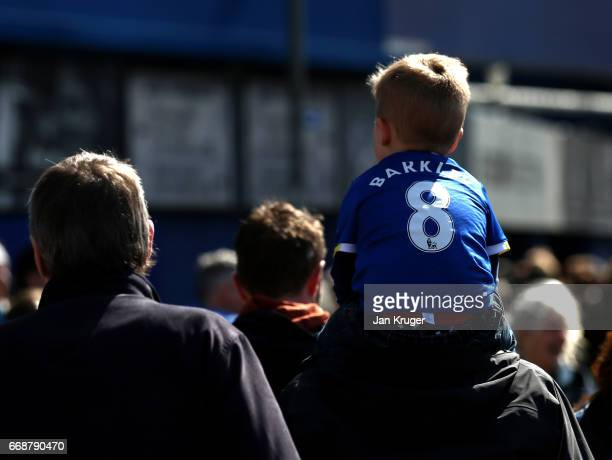 Everton fan is seen outside the stadium prior to the Premier League match between Everton and Burnley at Goodison Park on April 15 2017 in Liverpool...