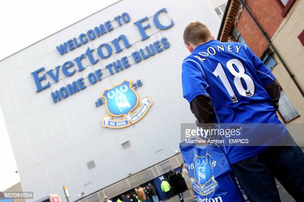 A Everton fan wearing a Wayne Rooney shirt makes his way to Goodison Park